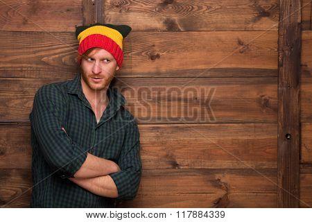 Hipster man in hat in studio