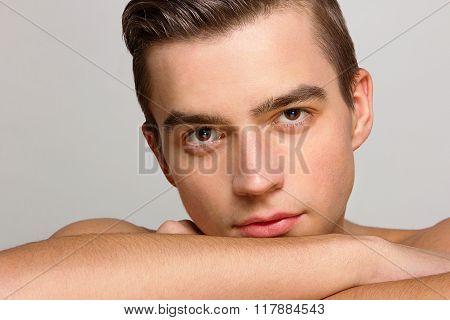 Young handsome man portrait, studio