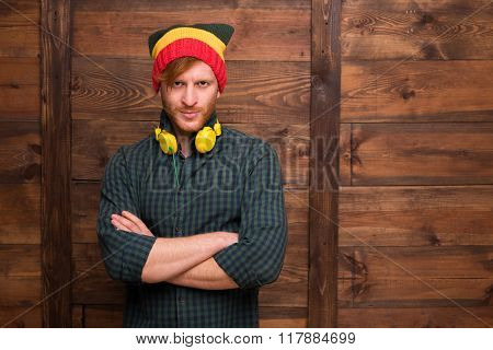 Hipster man in hat over wooden