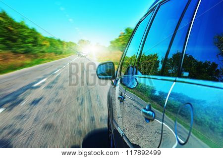 Blurred road and car, speed motion background