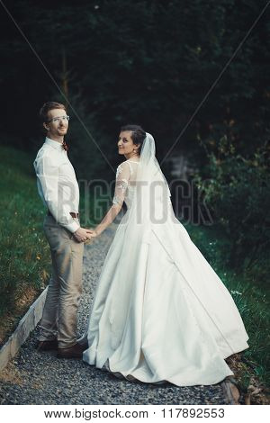 A young bride and groom standing together outdoor