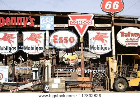 BARSTOW-CA, UNITED STATES - DECEMBER 22: A workshop with a forklift and old vintage and retro signs of different brands on December 22, 2015 near Barstow.