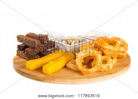Cheese sticks, onion rings, crackers, salted peanuts and sauce