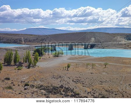 Bridge Over A Turquoise Blue River In Argentinian Patagonia
