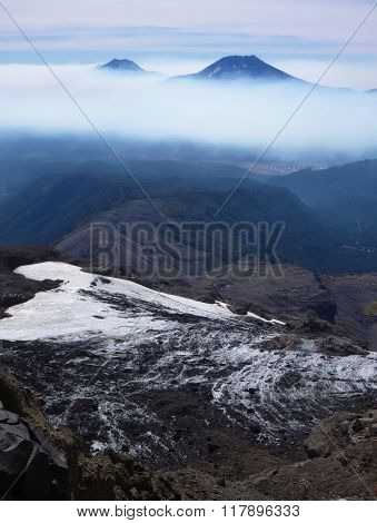 View Of Tolhuaca And Lonquimay Volcano Peaks From Sierra Nevada In Chile