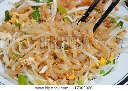 Pad Thai stir-fried noodle pick up in chopstick