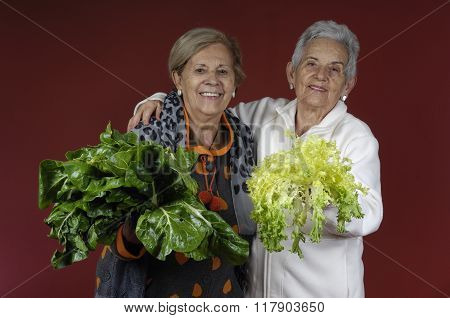 Two Senior Women With a Chard And a Endive
