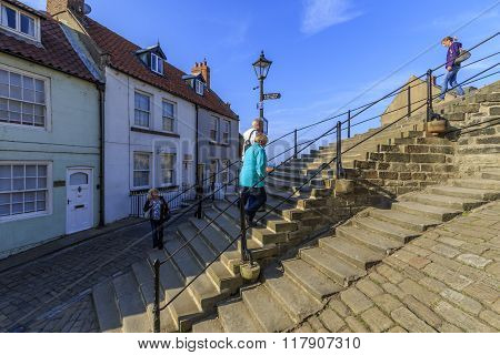 Whitby North Yorkshire UK 11th September 2015 people walking the 199 steps whitby.