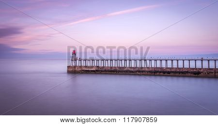 Whitby Pier Whitby North Yorkshire UK. long exposure