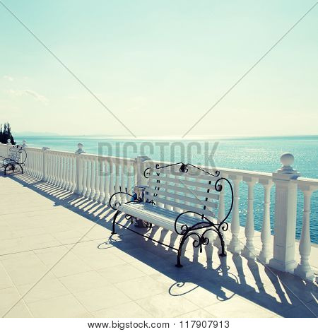 Classic White Balustrade, Bench And Empty Terrace Overlooking The Sea