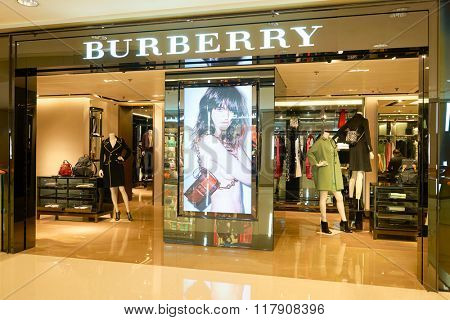 HONG KONG - JANUARY 27, 2016: shopwindow of Burberry store. Burberry Group plc is a British luxury fashion house, distributing outerwear, fashion accessories, fragrances, sunglasses, and cosmetics.
