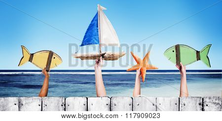 Beach and Wooden Plank Fence Hands Holding Toys Concept