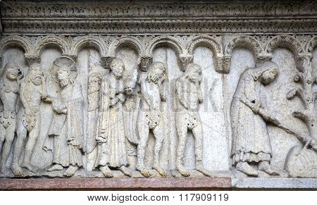 Stone Sculptures On The Exterior Of The Cathedral In Modena (italy)