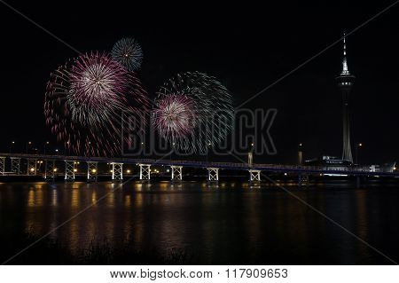 firework shows light up the sky with dazzling display near Bridge Ponte de Sai Van and Macau tower