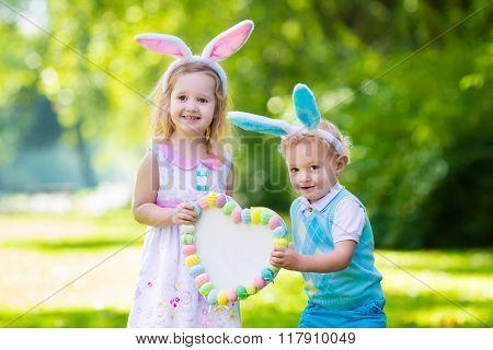 Kids Having Fun On Easter Egg Hunt