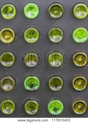 Bottoms of empty glass bottles lined up