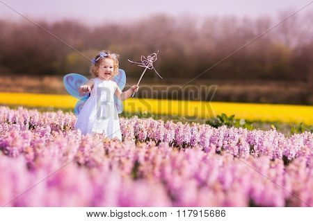 Little Girl Playing In Hyacinth Field