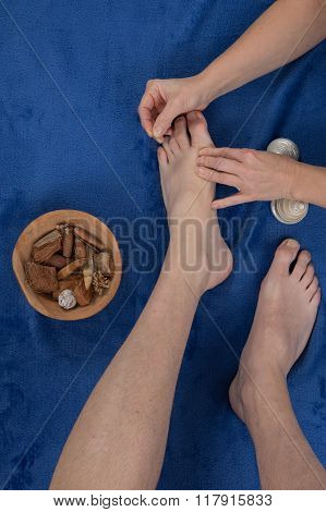A Male Patient Receives A Foot Acupuncture At Spa Center