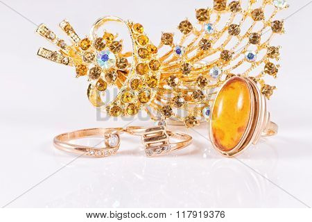 Big Gold Ring With Amber And Gold Brooch