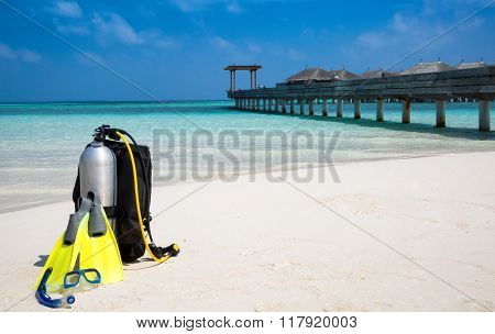 Scuba diving gear on Maldivian beach