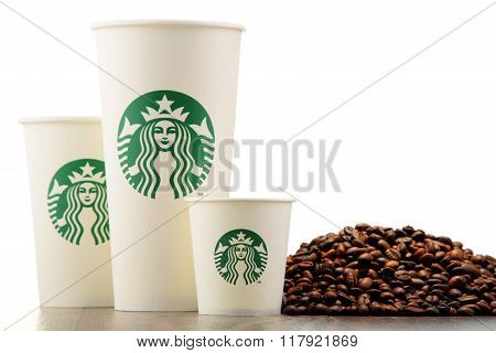 Composition With Cup Of Starbucks Coffee And Beans