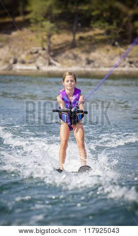 Young girl Water skier on a beautiful scenic lake