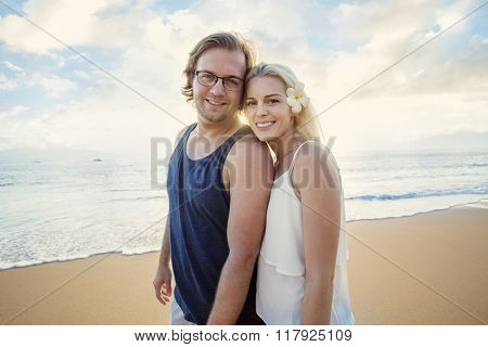 Happy couple enjoying an exotic island honeymoon together