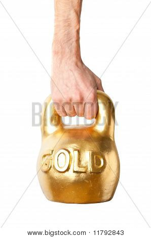 A Hand Holding Heavy Weight Of Gold