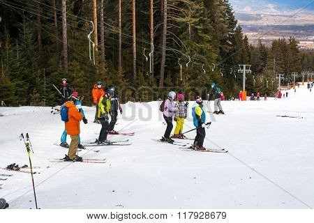Skiers on the slope, ski lift, mountains view in Bansko, Bulgaria