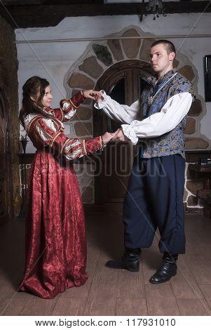 Attractive couple in retro dresses dances