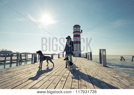 Fashionable woman posing with dogs outdoor