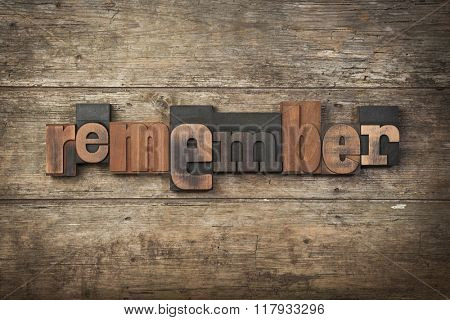 remember, word written with vintage wooden letterpress printing blocks on rustic background