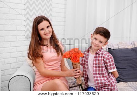 Son giving roses to his mother