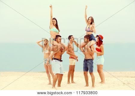 Beautiful young people having fun on beach