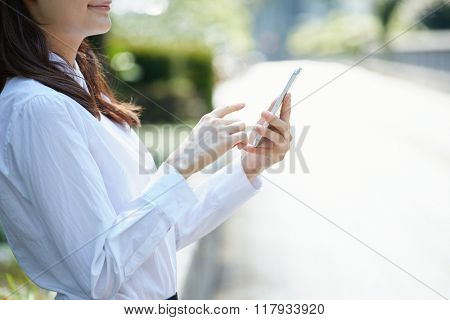 business woman with smart phone on hand