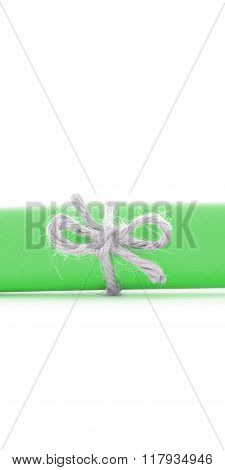Handmade Natural Rope Node Tied On Green Letter Roll Isolated