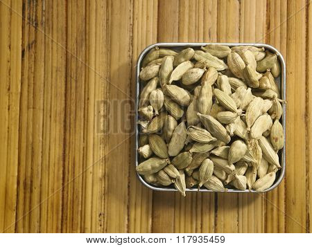 cardamon seeds on the bamboo background