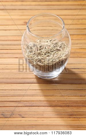 dried rosemary on the bamboo background
