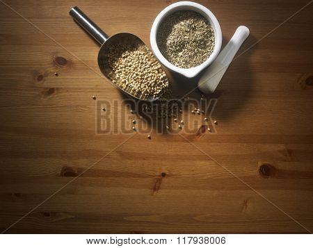 scoop of coriander seeds and cumin in mortar