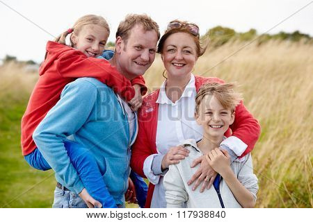 Parents With Children On Walk Through Countryside
