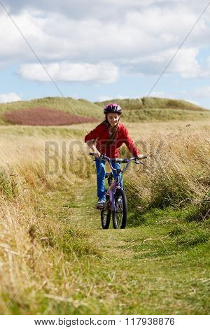 Girl Riding Bike Through Countryside
