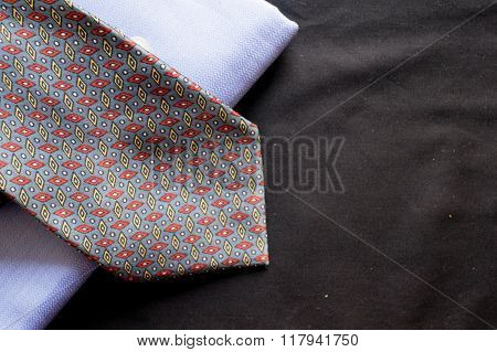 Blue fabric with tie on black