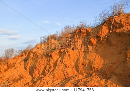 Sandy cliff on the banks of the river