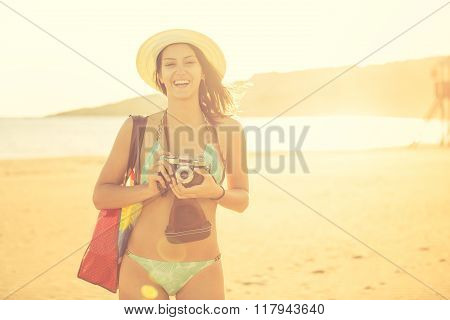 Attractive fit trendy modern hipster woman taking photos with retro vintage film camera