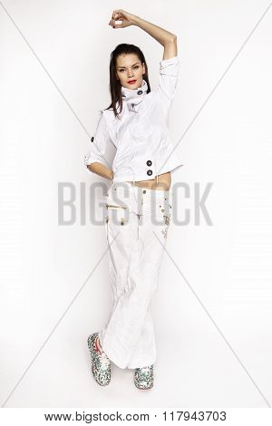 Woman in white jacket and pants