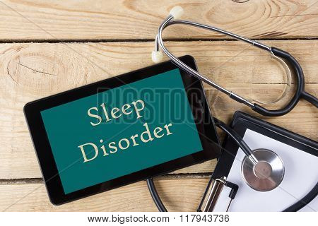 Sleep Disorder   - Workplace of a doctor. Tablet, stethoscope, clipboard on wooden desk background.