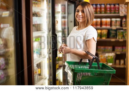 Cute Latin Woman At A Supermarket