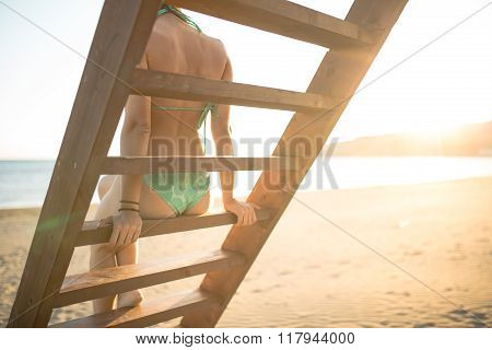 Sexy woman having fun in summer vacation holidays.Lifestyle summer portrait,lifeguard tower