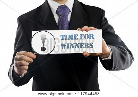 Close up businessman or salesman holding in hands magnifying glass and paper with Time For Winners m