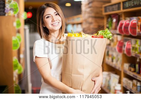 Cute Woman With A Shopping Bag At The Store